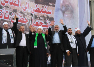 Salah Sultan (2nd from right) at Hamas Rally with Qaradawi
