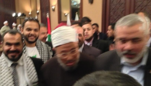 Sultan (left) with Qaradawi and Haniyeh in Gaza